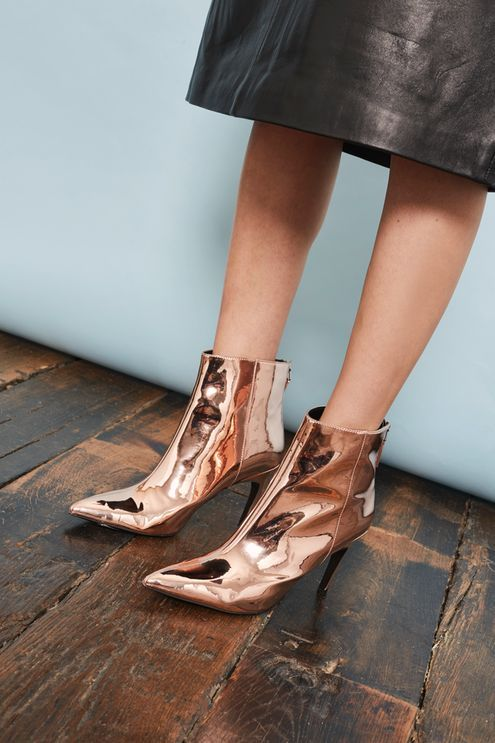 Every modern girl needs a pair of ankle boots. This chic pair in rose gold with a mirrored heel are disco-inspired and ready to give your look a dazzling edge for party season.