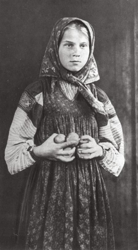 Russian costume, old photo. Peasant girl in a headscarf, 1900s.
