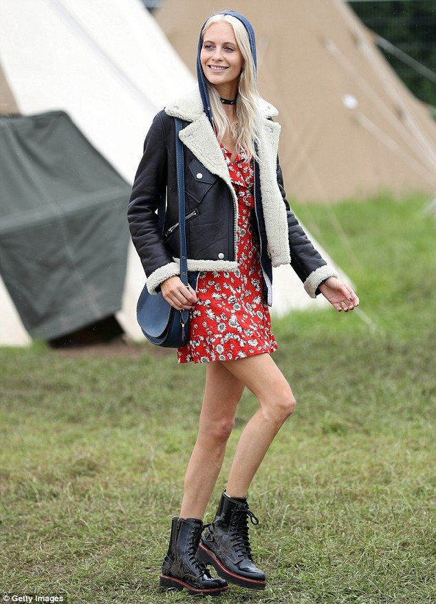 Flower power: Staying true to her name in a cherry red floral minidress, the mode, 30, put...