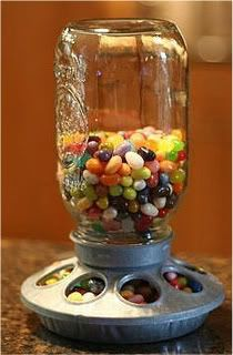 """Little """"Chicken"""" feeder...buy a cheap chicken feeder at a feed store...fill Mason Jar with candy and attach to feeder base---"""