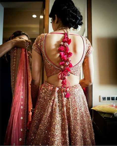 The layman trail on this #sabyasachi lehenga looks like a rose wild forest…