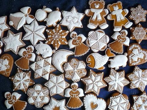 gingerbread cookies decorated in white icing ... note quilt-type patterns ...