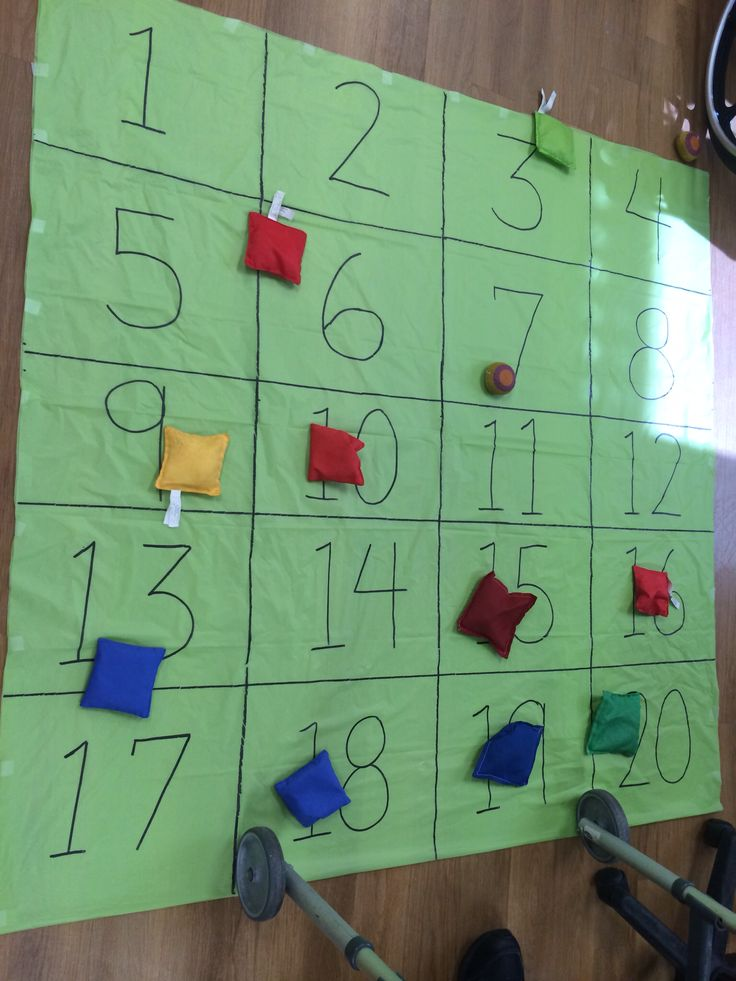 Beanbag toss Add cognitive component... How many days in a week... How many makes a pair... How many legs on a spider... Etc