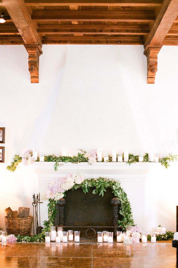 beautiful fireplace decor. candles and fresh flowers, is there anything better? Could