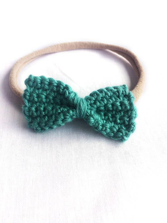 This beautiful simple crochet bow is the ideal accessory for your boho babe. Paired with the soft and stretchy nylon headband, these bows will not leave marks on delicate baby skin.  These bows are approximately 5cm x 2.5cm The headband will stretch to fit up to an older child  Product Safety All young children should never be left unattended or left to sleep wearing any sort of headband or hair accessory. Please ensure product is fully intact before each use.