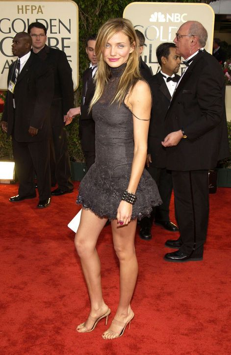 At the 2003 Golden Globes, Cammie showed off her perpetually killer legs in an ultra-mini Chanel Haute Couture lace dress and transparent heels—as if her stems need any lengthening tricks. Miles of bare leg, intentionally mussed hair, and one strategically fallen slip strap made for a memorably ultra-sexy, high-fashion statement.