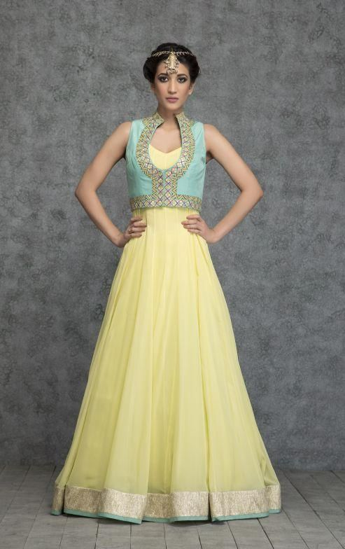 Out shine anyone in a party. Featuring a floor length sleeveless flaired pineapple delight anarkali with gold border and contrasting teal colored edges.It comes along with sleeveless fully embroidered silk teal colored jacket -www.cooliyo.com
