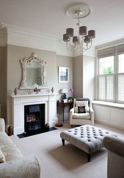 The neutral shades of taupe and grey in this London apartment give a subtle regal elegance to the sitting room.