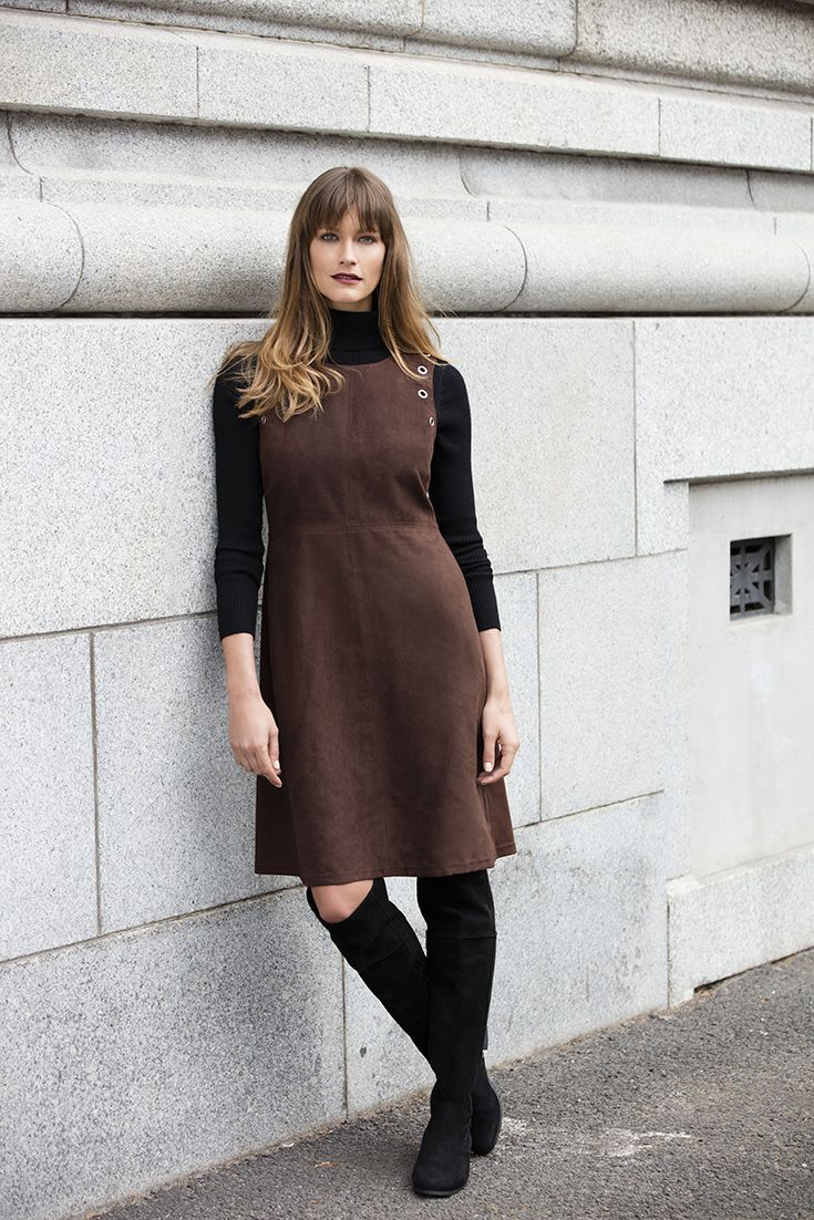The layered polo neck worn with a pinafore or bodycon dress and finished off with ankle boots or over the knee boots.