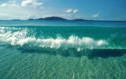 Jasné vlny na pláži tapeta