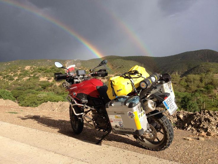 Alicia Sornosa's #BMW on her Half World Tour with a #DoubleRainbow in the background
