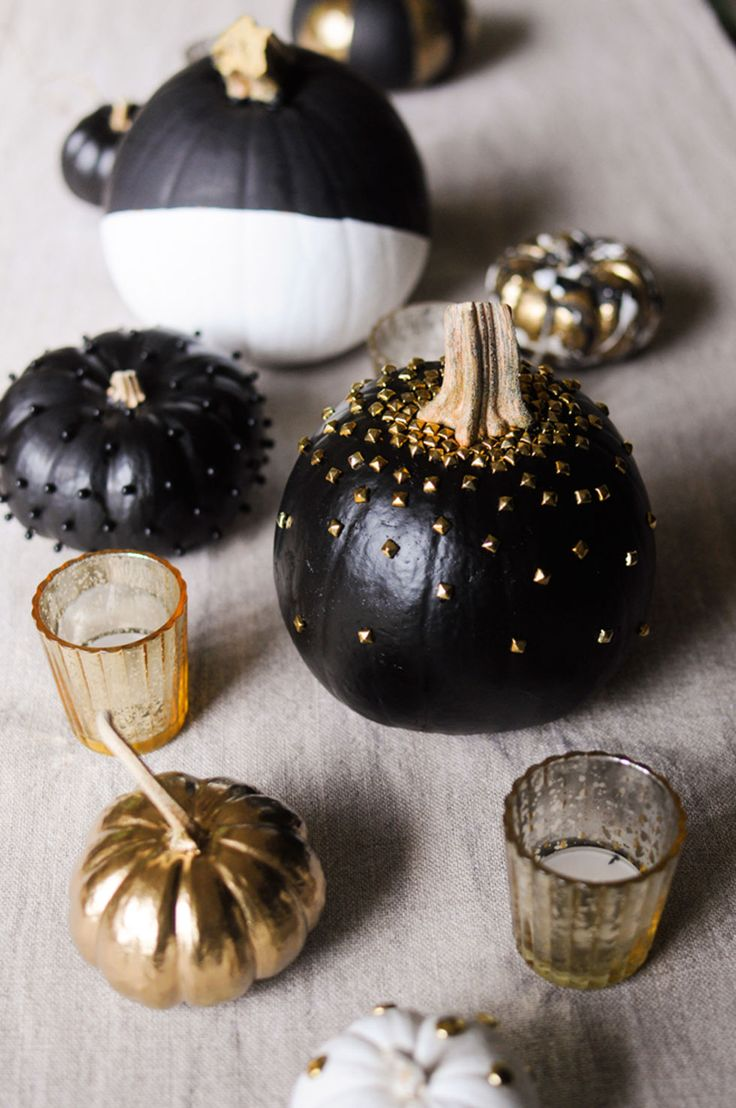 Fall Decoration & Fall Decor Ideas - STUDDED PUMPKIN - For pumpkins that are one part edgy, one part chic, embellish with metallic studs and black-and-gold acrylic paints. Use an artificial pumpkin to avoid a messy pile of goop, and painter's tape for a cool, color block design. Get the how-to at Redbookmag.com.: