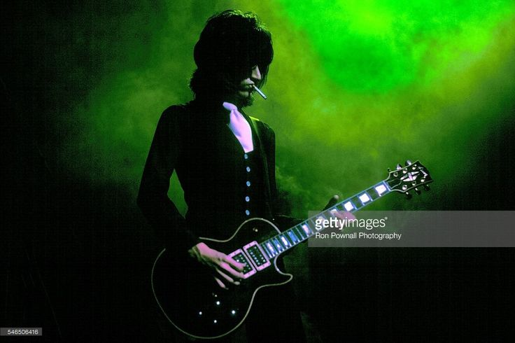 Aerosmith guitarist Joe Perry performs onstage in 1975.