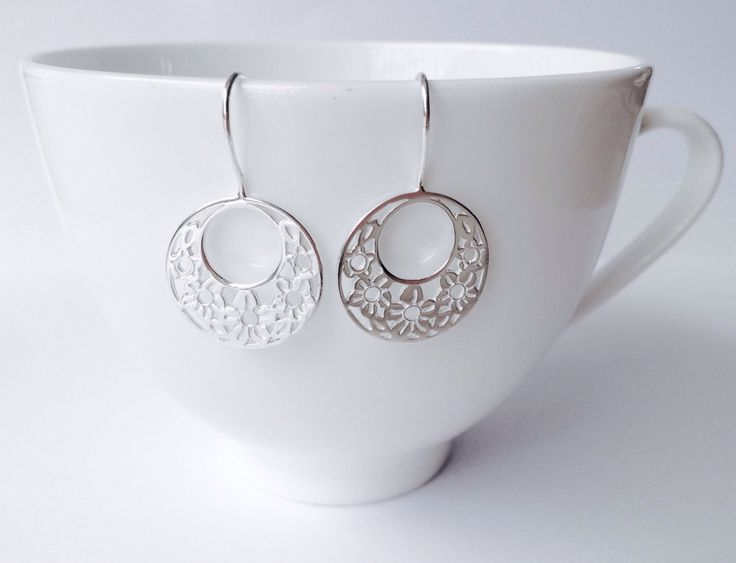 Round silver flower earrings from my Etsy shop https://www.etsy.com/listing/482321256/flower-wreath-drop-earrings-sterling.  #roundearrings #hookearrings #flower #handmade