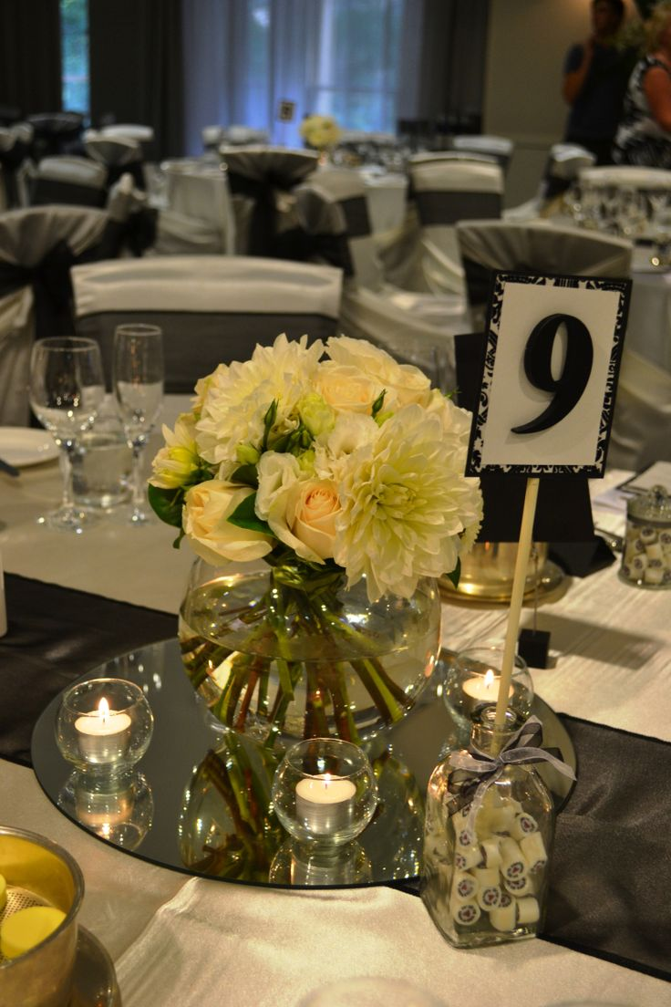 Black and white wedding reception. Guest table floral centrepiece. Styled by Greenstone Events.