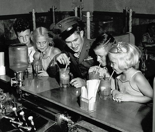 Medal of Honor winner Ricky Sorenson at the soda fountain in Anoka, Minn., after coming home from fighting in the Pacific, 1945. (Photo courtesy of the Minnesota HIstorical Society)
