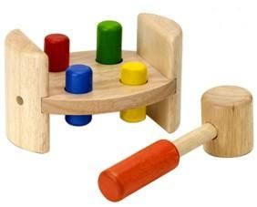 Hammer and roll  Our Classic Pounding Toy! Children will play while developing thier hand-eye coordination by pounding on the colourful wooden pegs.  The wooden base allows the toy to be rolled on the floor.