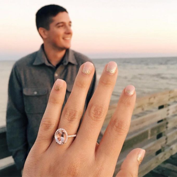 Brides.com: . A selfie showing off a pink-hued engagement ring (with a mani to match!).