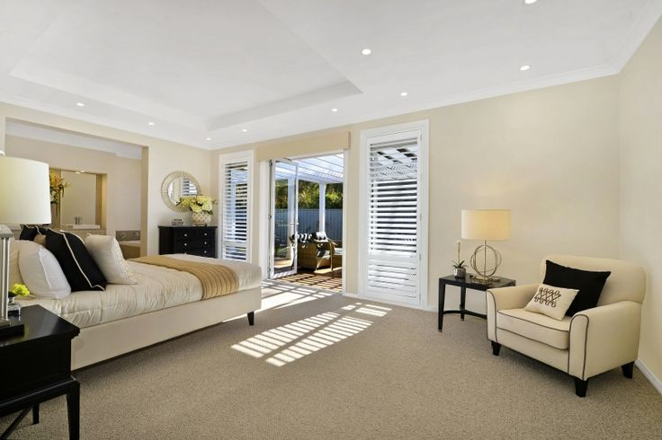 Beautiful and luxurious Hamptons styling in our Bronte Grande Manor One on display in Braemar. Love the coffered ceiling and easy access to the outdoors in this master suite! For details see http://mcdonaldjoneshomes.com.au/display-home-locations/braemar. #hamptons #interiordesign #design #newhome #home #bedroom #mastersuite #patio #bed #architecture #architecturaldesign #Hampton #occasionalchair #bed #bedsidetable #lighting #chair #cofferedceiling