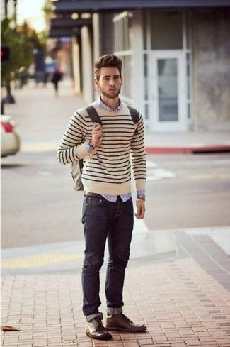 Men's Light Violet Dress Shirt, Beige Horizontal Striped Crew-neck Sweater, Navy Jeans, Dark Brown Leather Desert Boots, Brown Leather Backpack, and Brown Leather Belt