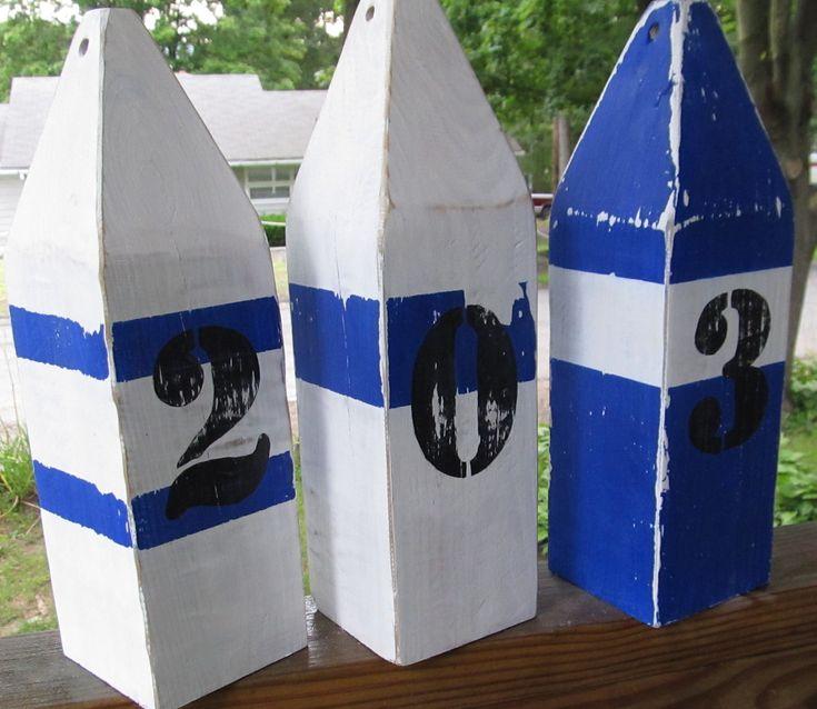 OOAK Reclaimed Wooden Buoys Set of 3. Made to Order. Lake decor Nautical Decor. Beach Decor. $50.00, via Etsy.