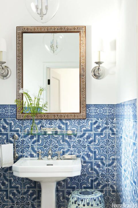 Gorgeous patterned blue and white tiles are a timeless look for any bathroom!