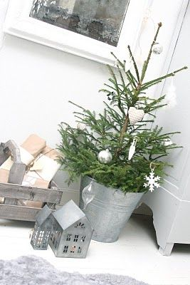 Love the tree in the galvanized tin bucket with just a few ornaments. Mini trees are so cute!