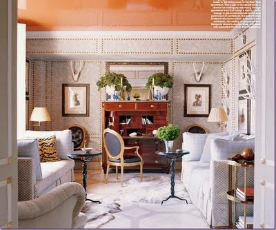 jeffrey bilhuber liivng room--glossy lacquered ceiling, wallpaper with nailhead trim, geometric painted floors, secretary desk, carved armchair