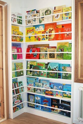 Colorful corner library. A great use of space, although you might need a step or ladder! Unique idea for a modern playroom or kid's room.
