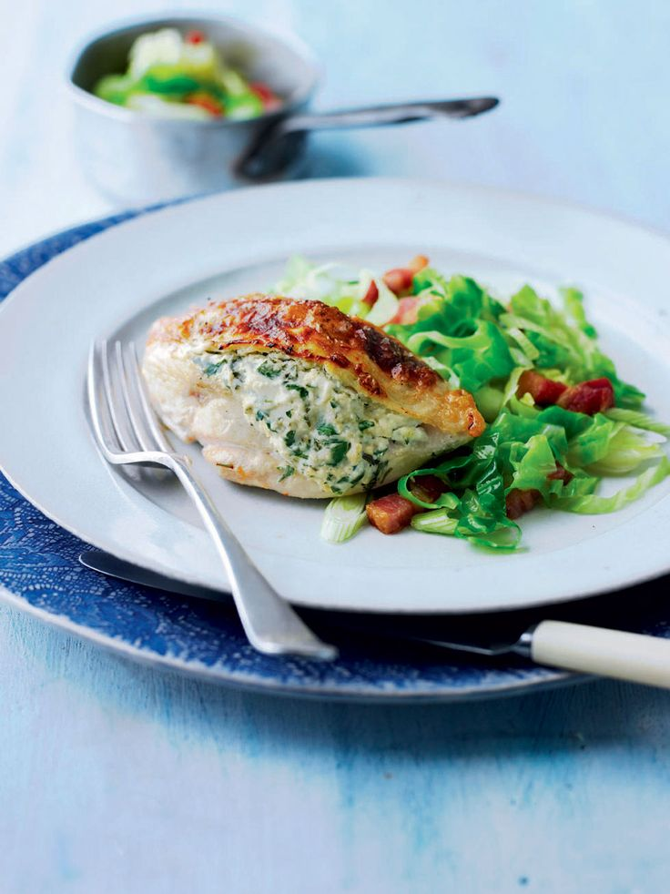 This cheesy stuffed chicken recipe benefits from a side order of crunchy cabbage and salty bacon.