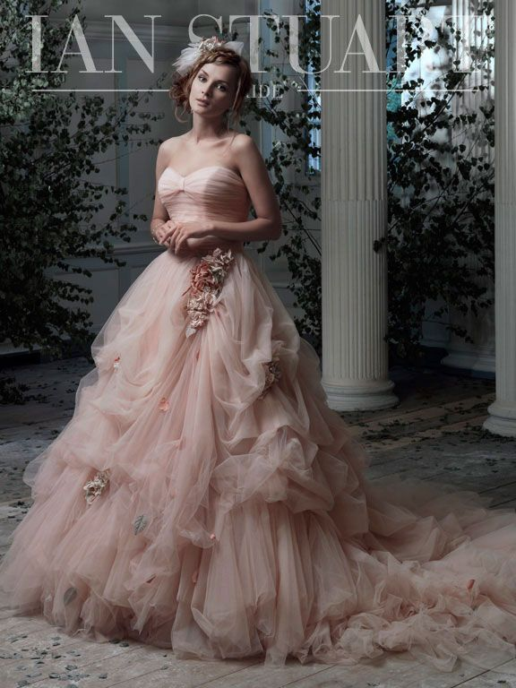 Curvee Rose by Ian Stuart This wonderfully romantic gown has a soft sweetheart neckline with a lightly draped bust cup and bodice.  The dramatic A line skirt, adorned with scattered flowers and delicate pick ups, is designed to make the woman who wears it bask in her own femininity!