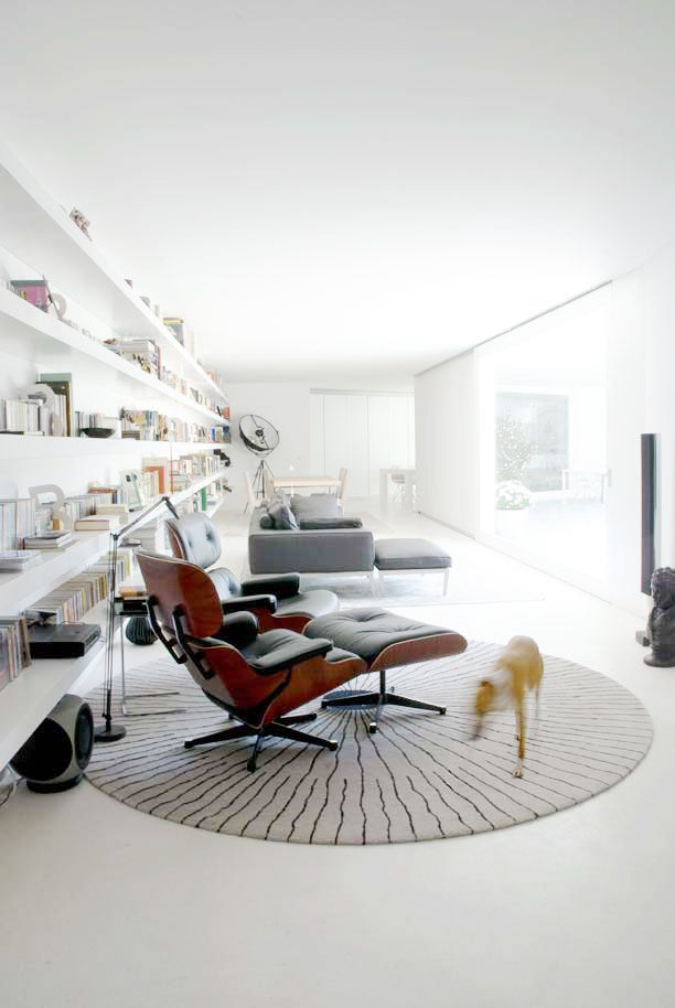 long shelves and eames lounge chair