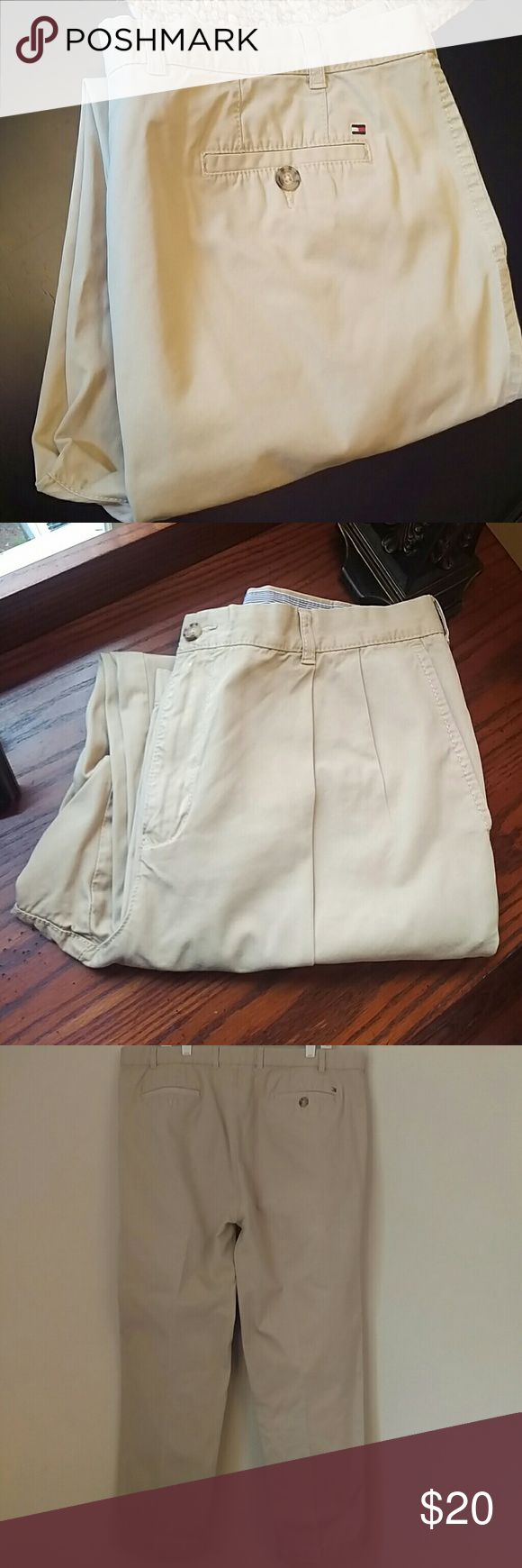 Men's Tommy Hilfiger Khaki Pleated Chino's Pleated khaki chino's by Tommy Hilfiger. Only professionally cleaned. No flaws. Like new. 40 waist, 30 length. Tommy Hilfiger Pants Chinos & Khakis
