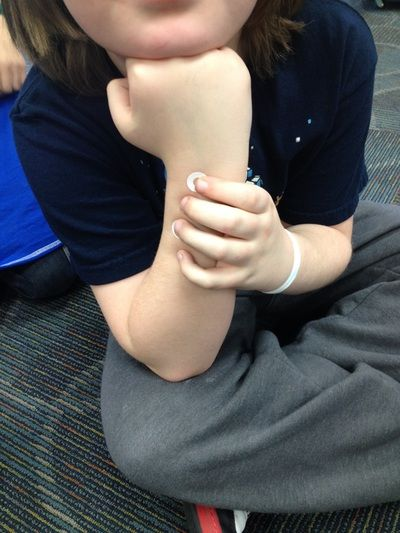 """Using hole reinforcers to help students learn finger placement.  It's an """"arm recorder' to use with students before they get a real recorder in their hands.  No squawking with these!"""