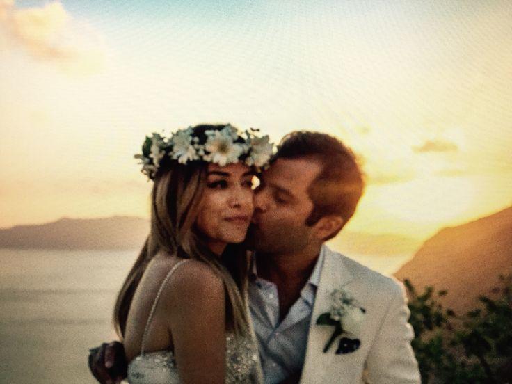 Groom kisses bride,Santorini