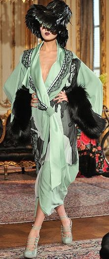 Sea foam green with black fox and black lace, Christian Dior, definitely inspiration from the 1920s with that deep neckline and bell shaped hat