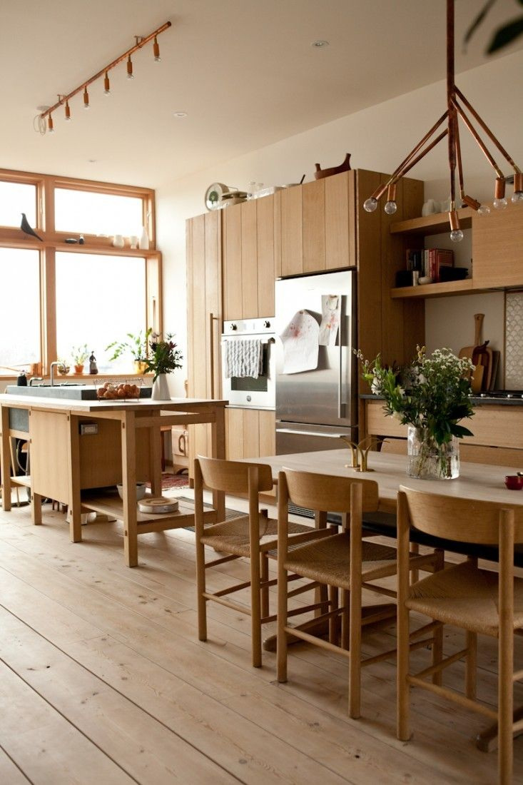 Classic Danish dining furniture blends effortlessly with the warm oak kitchen.Photograph by Juli Daoust.