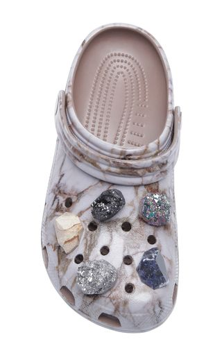These **Christopher Kane** crocs are rendered in rubber and feature a marble texture and the signature crocs style.