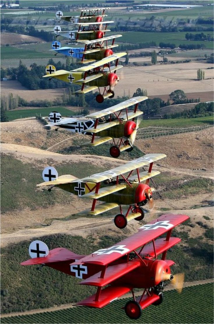 """A re-enactment of the World War I German """"Flying Circus"""" of Fokker Dr.I """"Dreidecker"""" tri-planes led by the Red Baron, Manfred von Richthofen."""