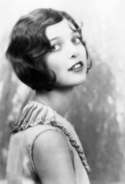 The unique and elegant style of 1920's women's fashions - The Bob! Illustrating once again an androgynous look.
