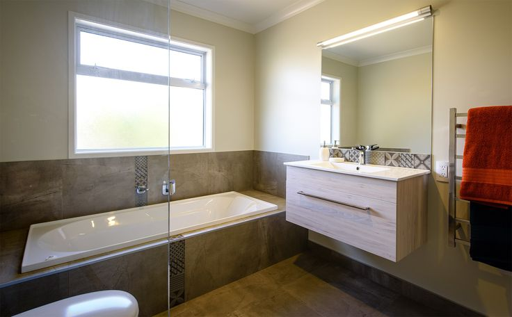 Relax in the built in bathtub in this G.J. Gardner  home.
