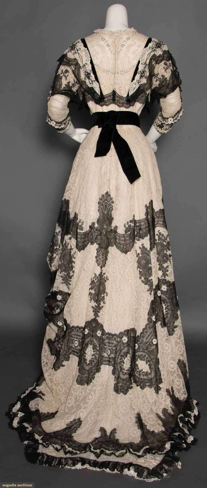 White and black lace dinner gown, 1-piece, cream Valenciennes lace w/ black chantilly lace swags on bodice & lower hem, princess lines, scoop neck, short sleeves, bodice w/ jet & turquoise beads & jet ovals, ca 1902