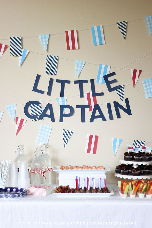 little captain nautical themed baby shower inspired by moby dick baby book via confetti