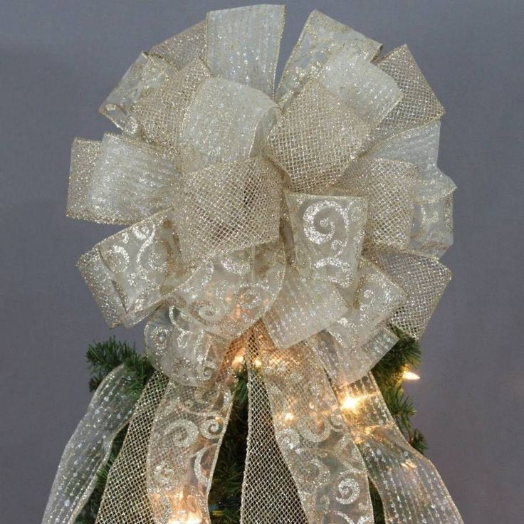 Elegant gold swirl mesh Christmas tree topper bow is created with 3 deluxe gold wire edge ribbons. This gold Christmas holiday bow is perfect as a tree topper or decorating a wreath or mantel. Bow Det
