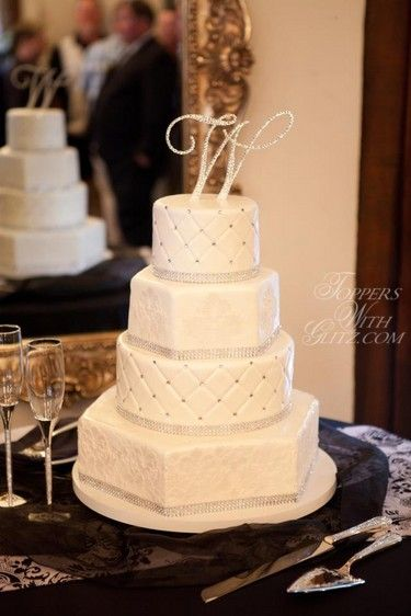 Crystal letter cake topper, toasting glasses, and server set by Toppers With Glitz.