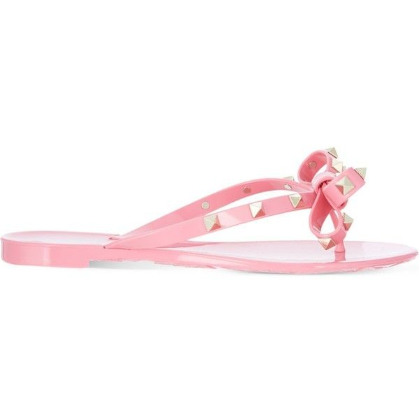 Valentino Rockstud studded bow flip-flops ($260) ❤ liked on Polyvore featuring shoes, sandals, flip flops, valentino sandals, pink bow sandals, spiked sandals, bow flip flops and valentino flip flops