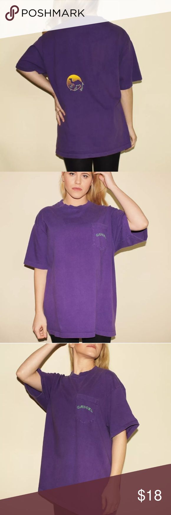 """Camel Cigarettes Tee Shirt CAMEL T Shirt Purple L  DESCRIPTION 🐪  Vintage 90s Camel cigarettes t shirt with Camel print on back. Oversized with short sleeves and the Camel logo on the chest pocket. Circa 1993. Unisex. Very good condition. Has same fading.     MEASUREMENTS 🐪  ~ Size: Best Fits a Large  ~ Size on Tag: None  ~ Shoulder to Shoulder: 21""""  ~ Sleeve Length: 8.5""""  ~ Bust: 44""""  ~ Waist: 44""""   ~ Length: 28""""   All measurements are taken by laying item flat. Bust, Waist and Hips are…"""