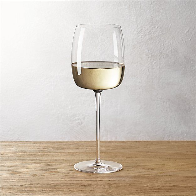 Shop cru wine glasses.   An elegant update to the perennial classic.  Atop a delicate pulled stem sits a flat base bowl with rounded pillow-top silhouette.  Stunning in its simplicity.  Handmade top to base.