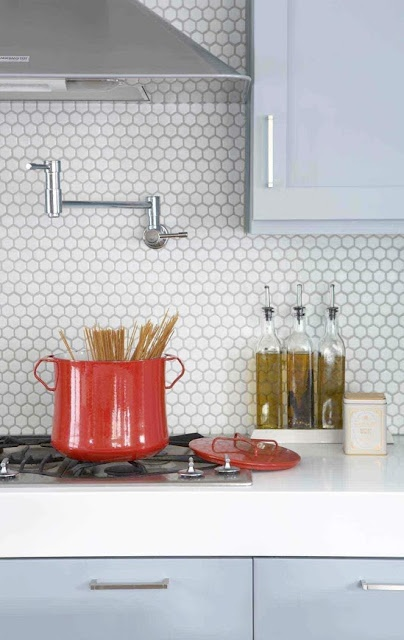 Penny-round tile backsplash and gray cabinets
