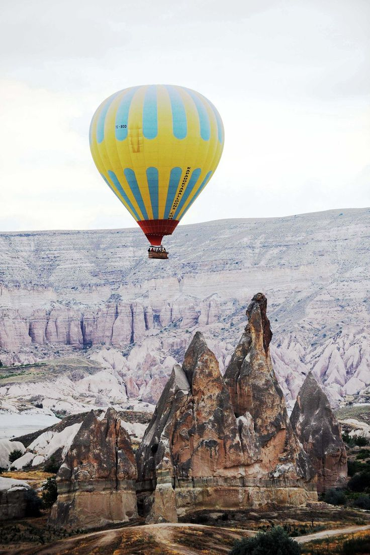 15 Budget Travel Destinations Cappadocia, Turkey The quintessential experience is floating over the landscape in a hot air balloon, and they generally take off in the early morning hours to see the sunrise. Most of the activities are for the outdoorsy — hiking to various rock formations and exploring caves in Ala Dağlar National Park.